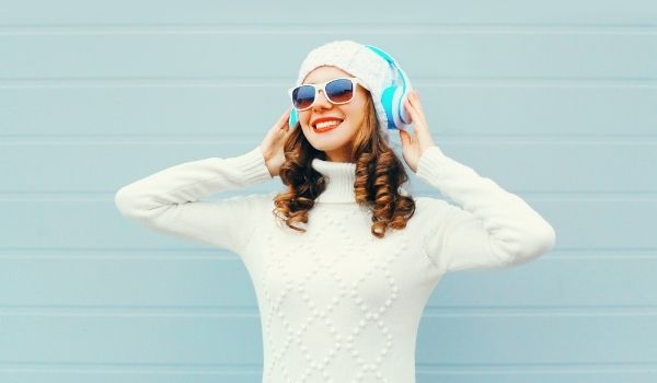 girl listening to music with blue headphones
