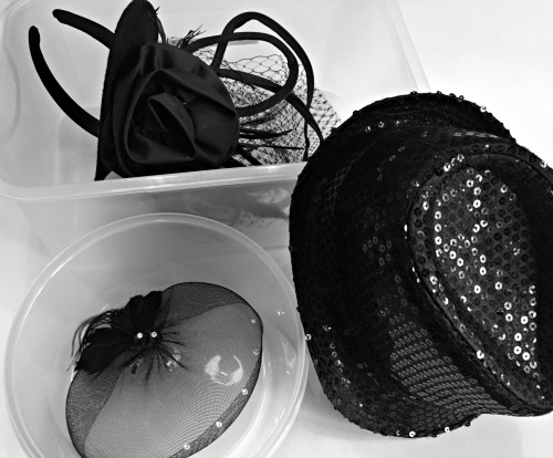 packing hats and hair accessories for dance